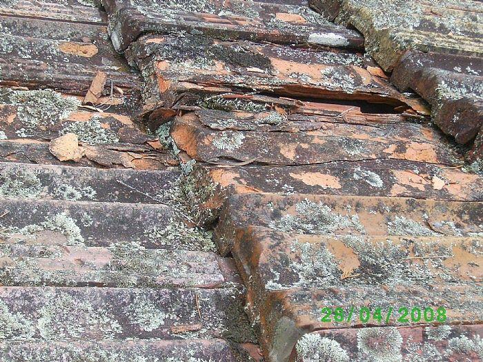 80-year-old terra cotta tile roof before restoration
