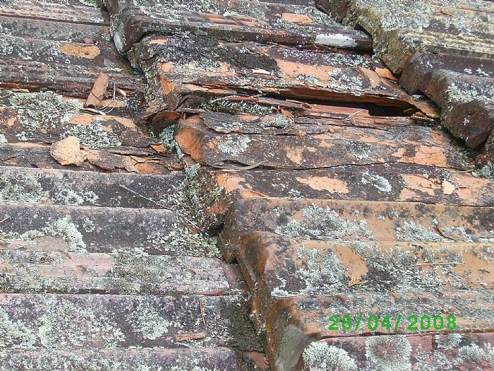 80-year-old terra cotta tile roof before restoration