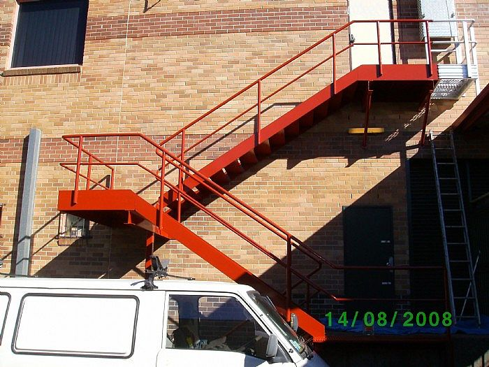 This rusty fire stair was treated and repainted - Penrith